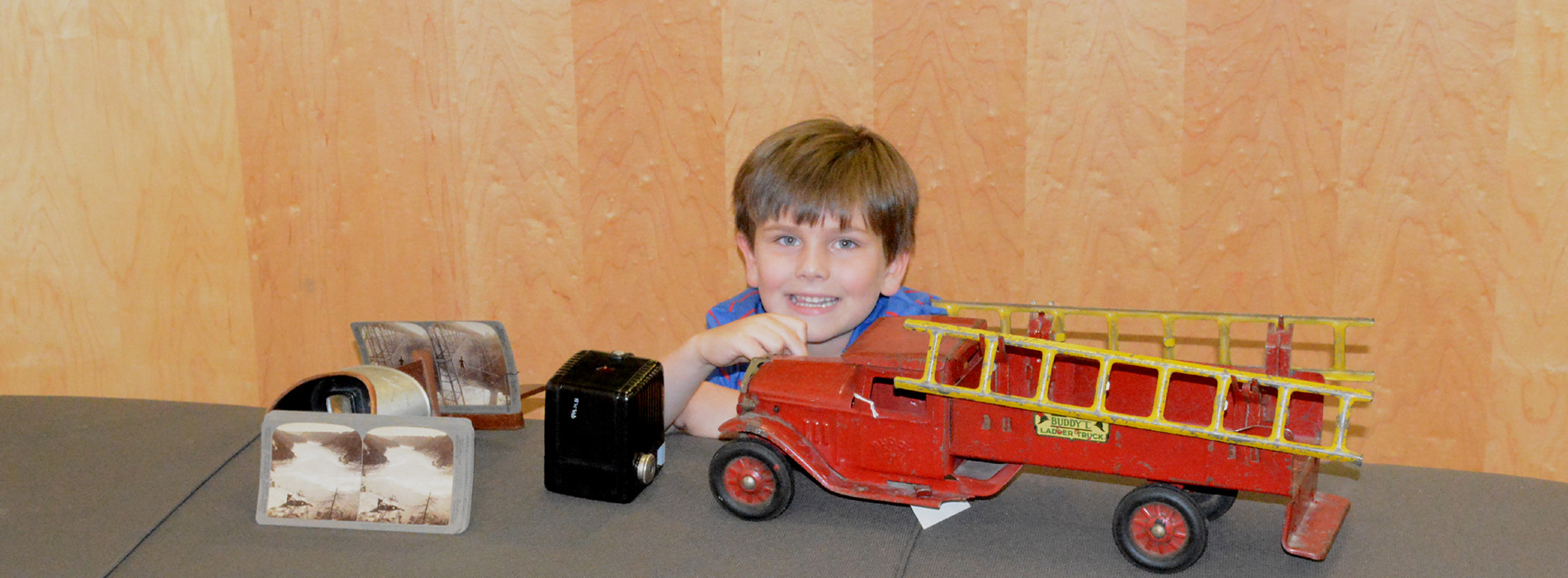 Child with Old Fire Engine